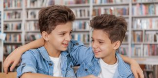 https://image.freepik.com/free-photo/happy-young-twin-brothers-laughing-hugging-library-while-doing-school-assignment-together_130388-1249.jpg