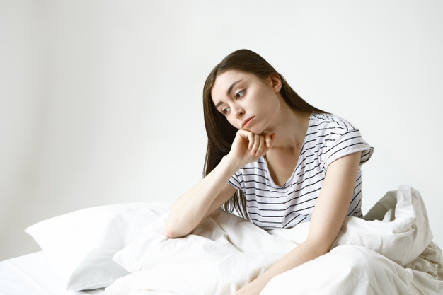 https://image.freepik.com/free-photo/upset-beautiful-young-woman-with-long-brown-hair-sitting-bed-having-pensive-look-unwilling-go-work-feeling-sick-tired-her-boring-monotonous-life_343059-1438.jpg