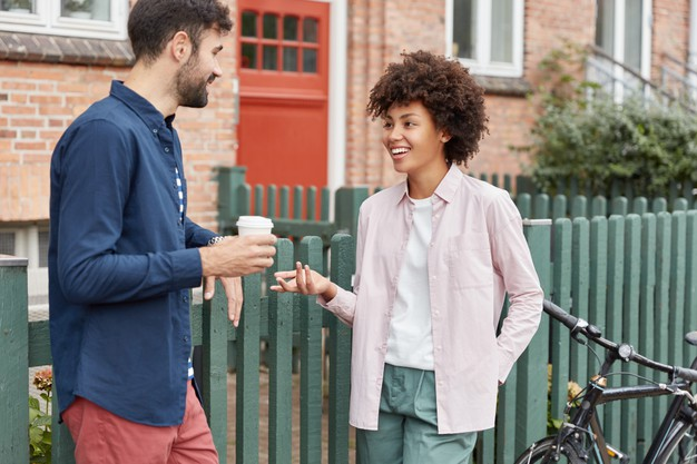 https://image.freepik.com/free-photo/positive-multiracial-couple-walk-rural-setting-stroll-during-weekends-drink-takeaway-coffee-stand-near-fence-have-pleasant-talk-with-each-other_273609-18702.jpg