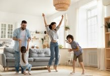 https://image.shutterstock.com/image-photo/happy-parents-kids-dancing-modern-600w-1835861653.jpg