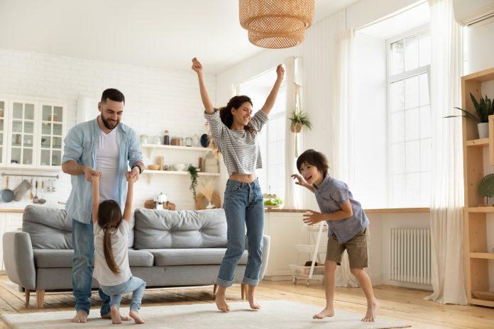 https://image.shutterstock.com/image-photo/happy-parents-kids-dancing-modern-600w-1835861653.jpg